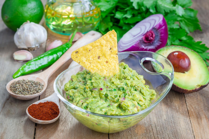 Bowl with guacamole and ingredients royalty free stock photography