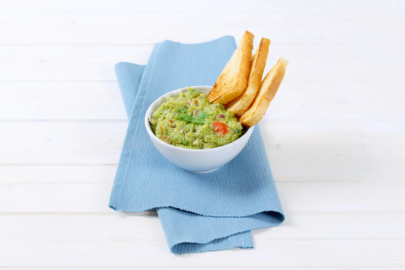 Download Bowl Of Guacamole With Toasts Stock Photo - Image: 83709695