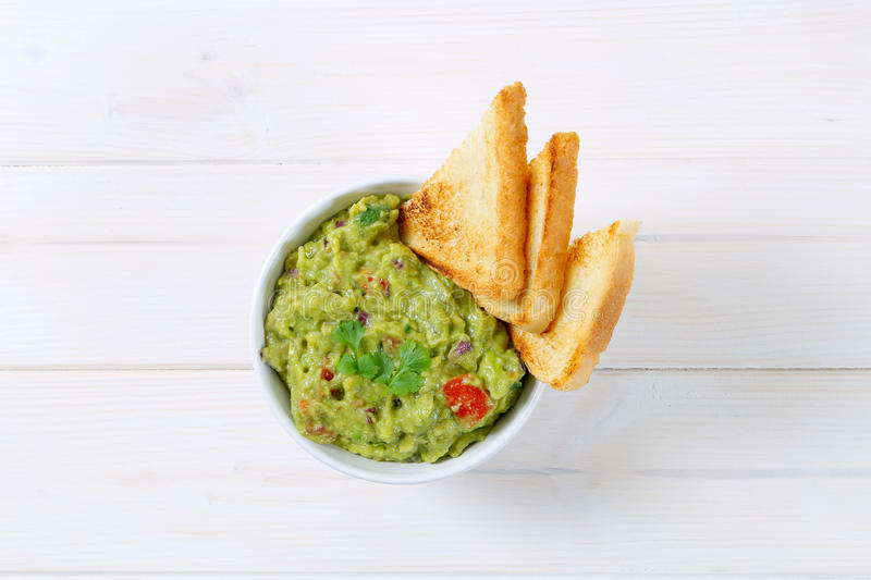 Download Bowl Of Guacamole With Toasts Stock Image - Image: 83708383