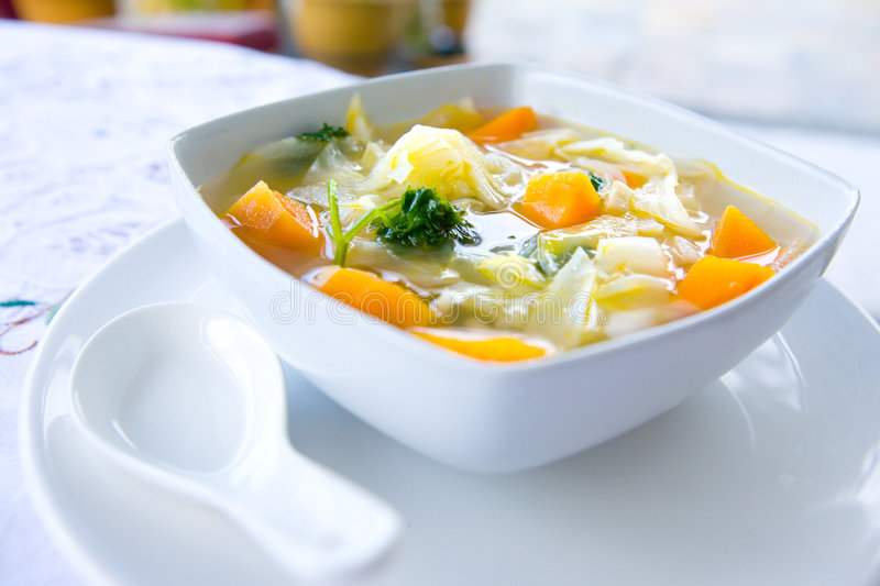 Bowl of healthy cabbage and sweet potato soup stock images