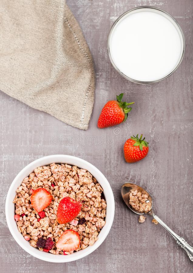 Bowl of healthy cereal granola with strawberries royalty free stock photo
