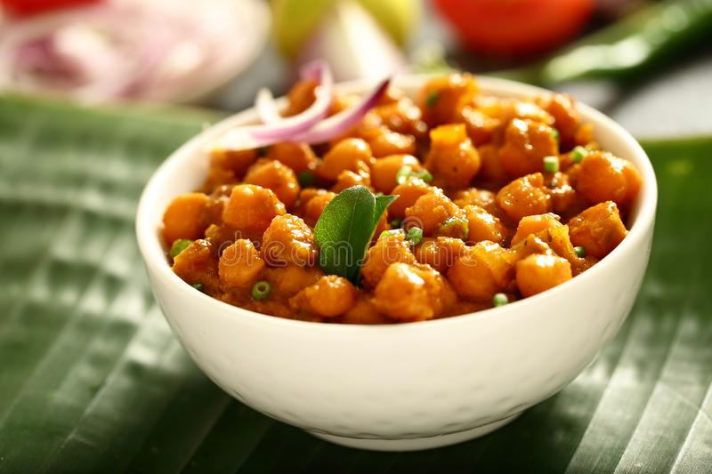 Bowl of Homemade Chickpea curry.Indian vegan food. Indian cuisine- homemade chickpea curry,channa masala served with flat breads ,tandoori roti royalty free stock images