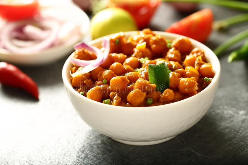 Bowl of Homemade Chickpea curry.Indian vegan food. Indian cuisine- homemade chickpea curry,channa masala served with flat breads ,tandoori roti stock images