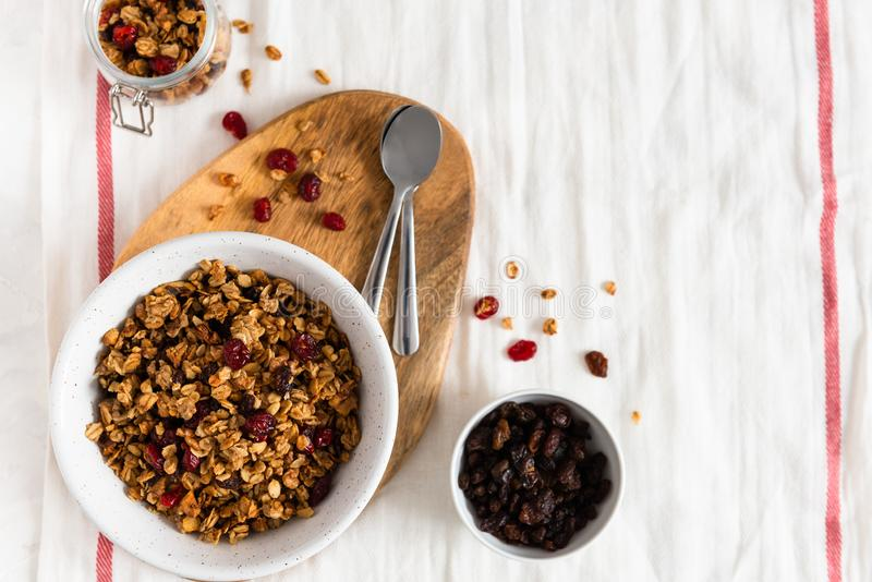 Bowl of homemade granola with nuts and fruits on white linen background. Top view, copy space royalty free stock images