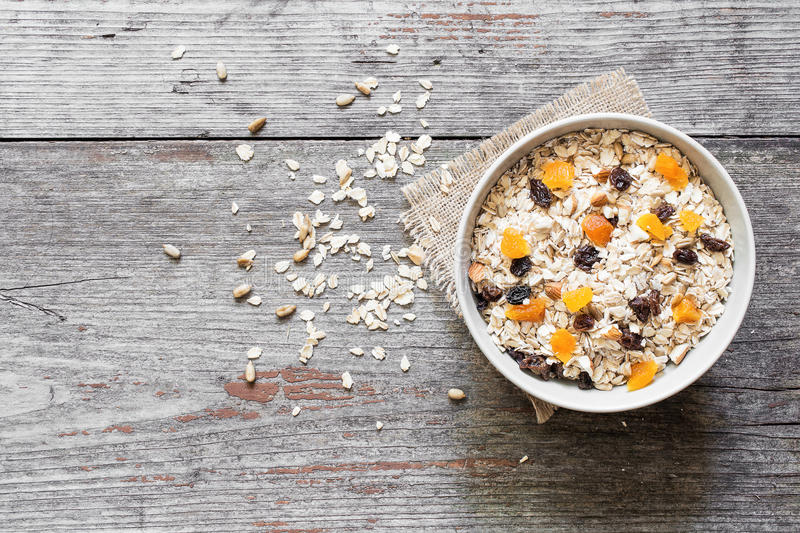 Bowl of homemade muesli with nuts, dried fruits and sunflower seeds royalty free stock photos