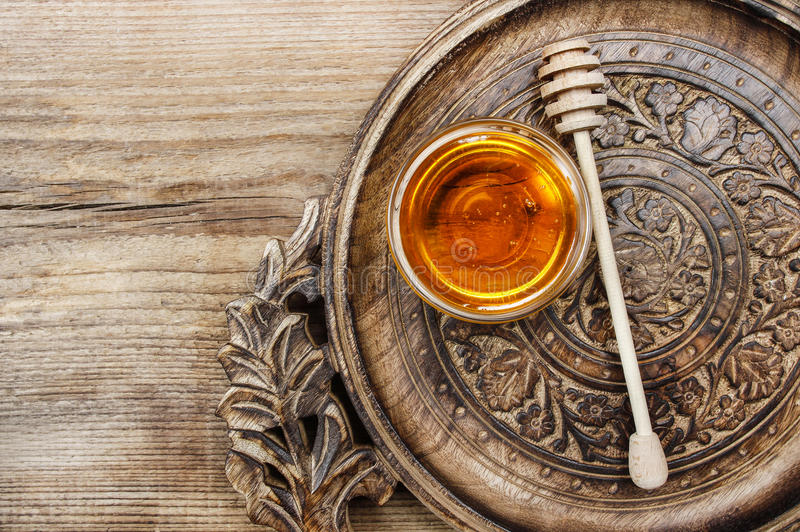 Bowl of honey on wooden table. Symbol of healthy living. And natural medicine. Aromatic and tasty. Top view royalty free stock images