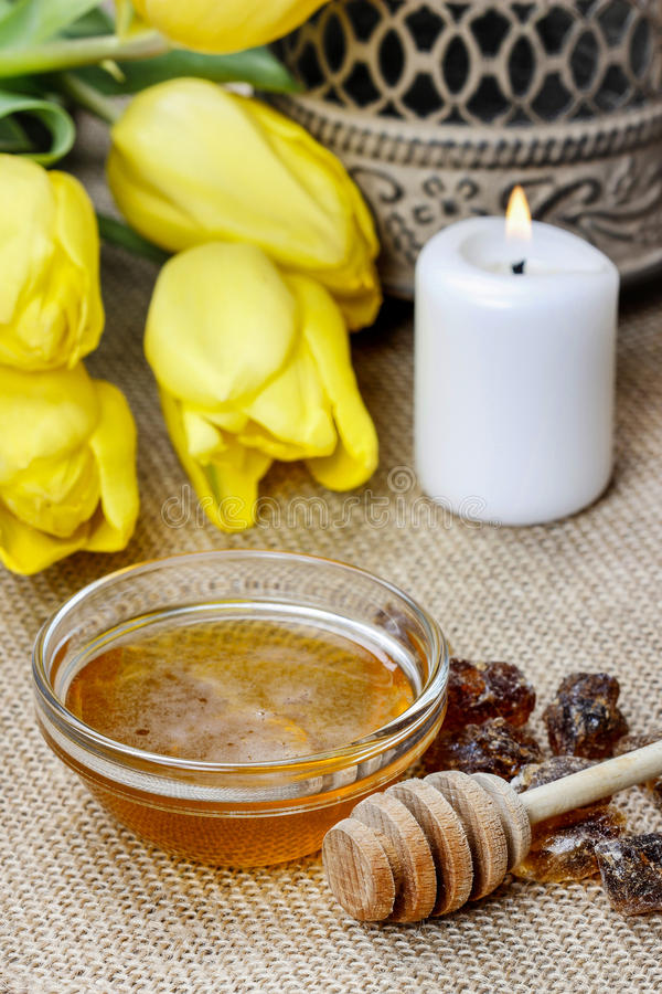 Bowl of honey on wooden table. Symbol of healthy living. And natural medicine. Aromatic and tasty royalty free stock photo