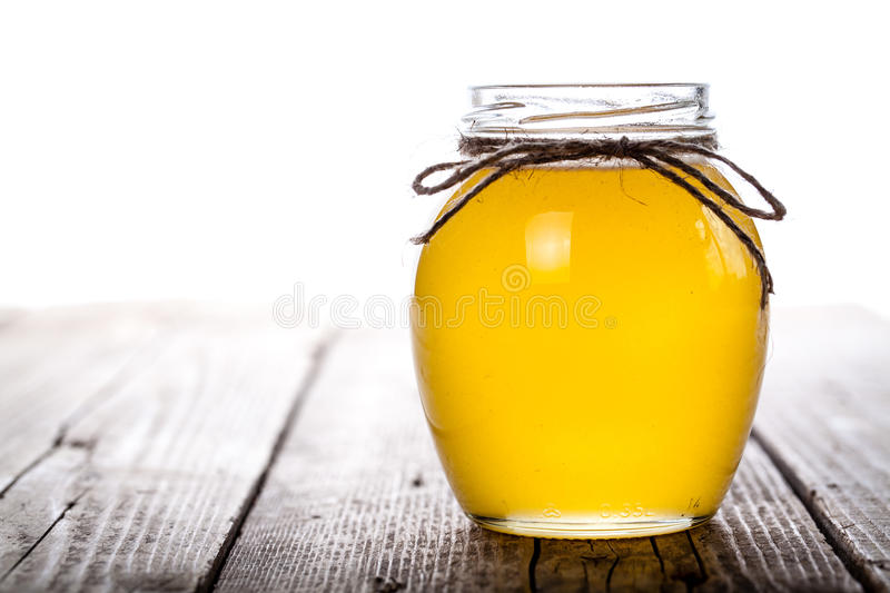 Bowl of honey on wooden table. Symbol of healthy living and natural medicine. Aromatic and tasty. And stock image
