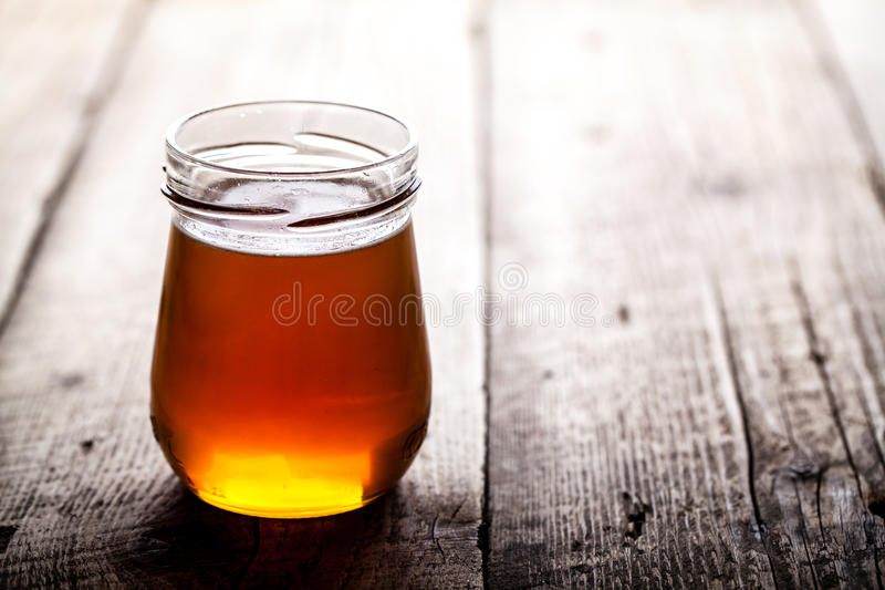 Bowl of honey on wooden table. Symbol of healthy living and natural medicine. Aromatic and tasty. And royalty free stock images