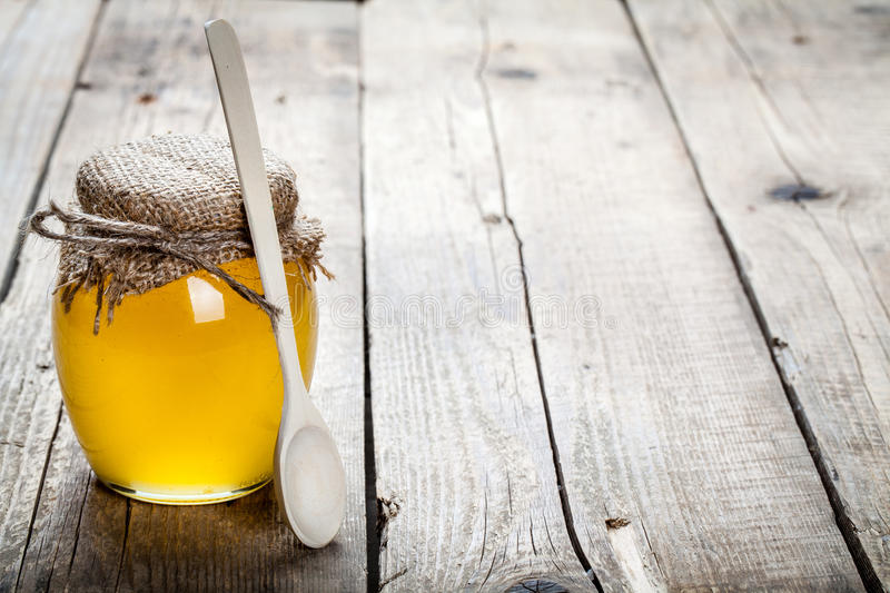 Bowl of honey on wooden table. Symbol of healthy living and natural medicine. Aromatic and tasty. And royalty free stock image