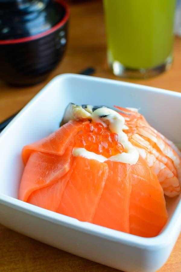 Bowl of Japanese mix sashimi don on rice. Close up of Bowl of Japanese mix sashimi don on rice stock photos