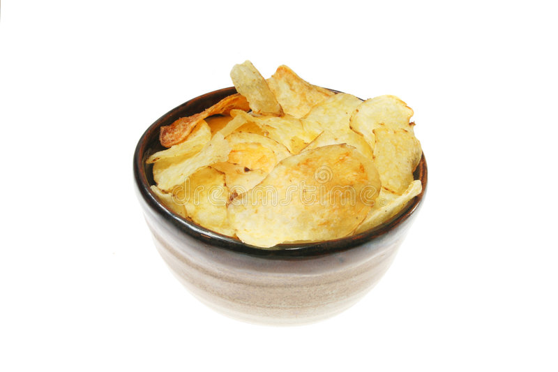 Bowl of kettle chips. Isolated on white stock image