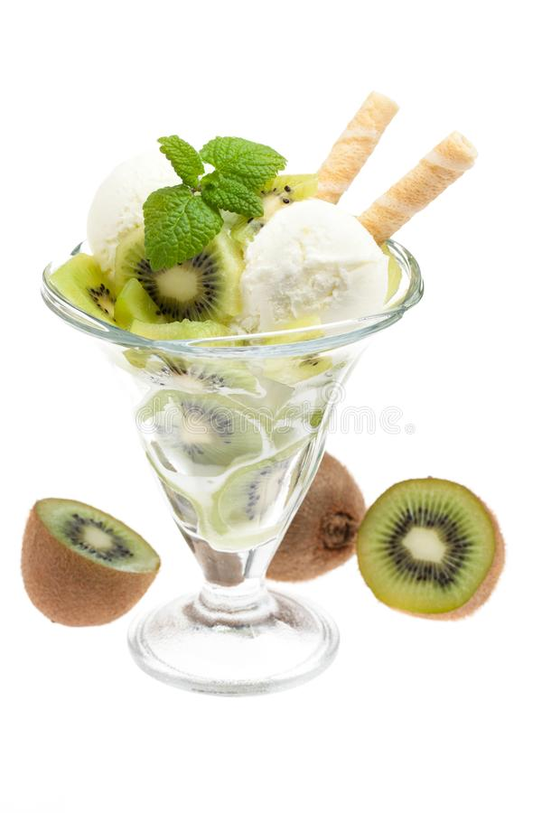 A bowl of kiwi ice cream with kiwis and cones isolated on white background with waffles royalty free stock photography