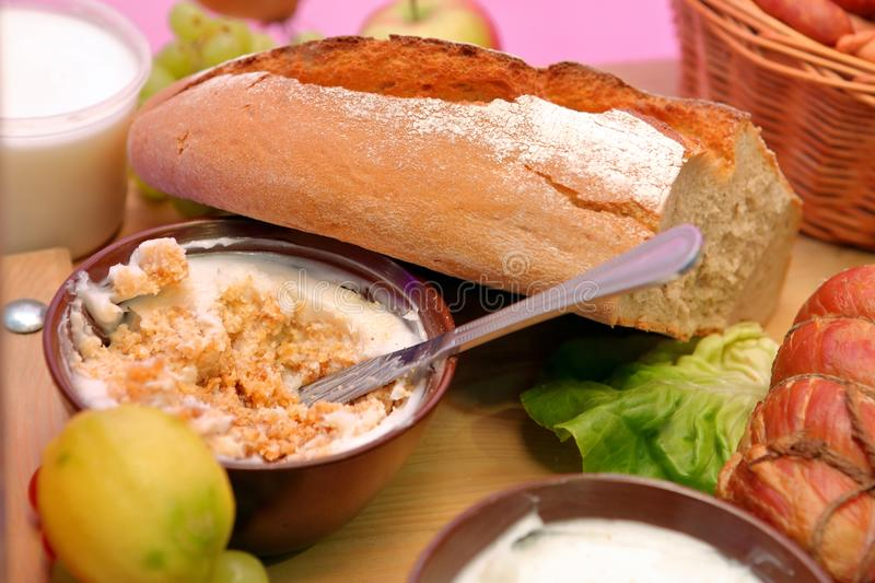 Bowl of lard and fresh bread on the table stock photography