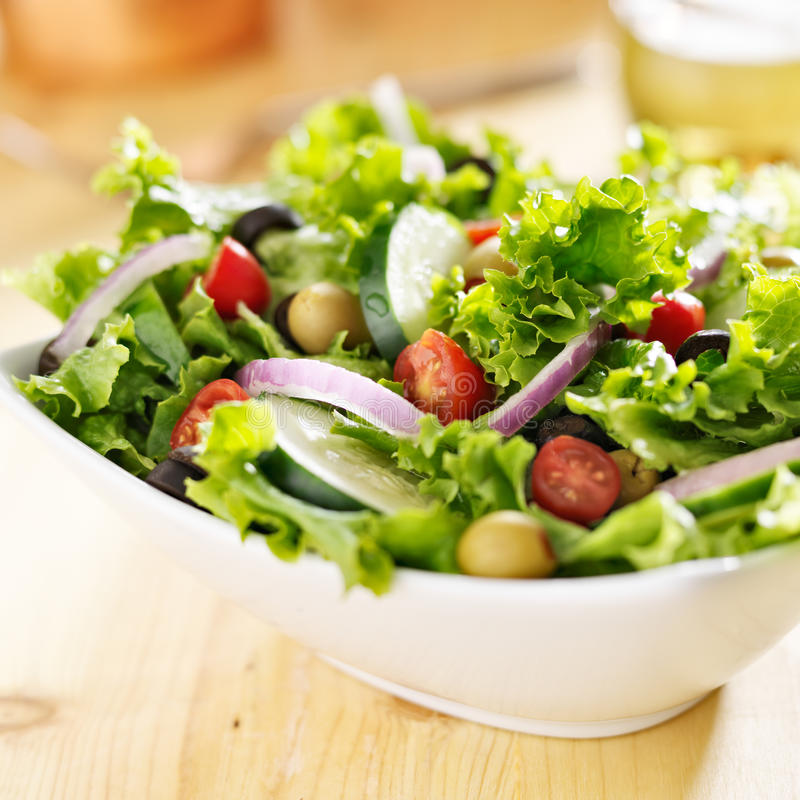 Bowl of leafy green salad stock image