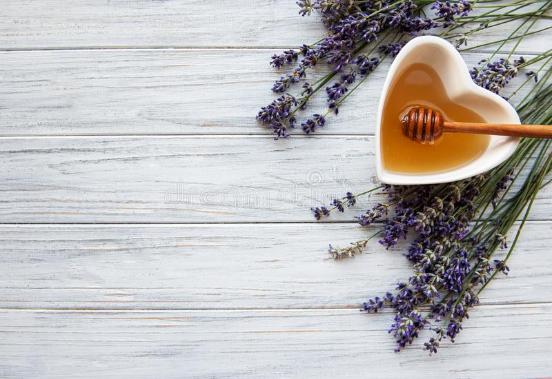 Bowl of honey with lavender royalty free stock photo