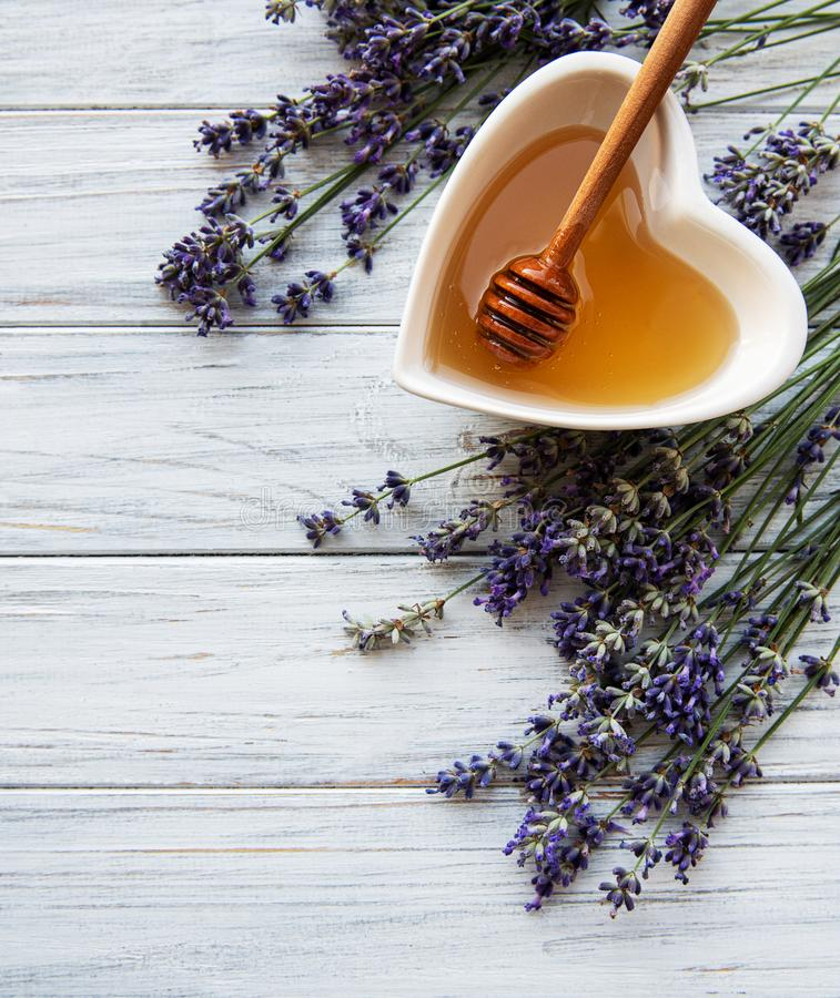 Bowl of honey with lavender royalty free stock photography