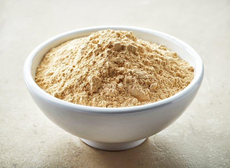 Bowl of maca powder. Bowl of healthy maca powder stock images