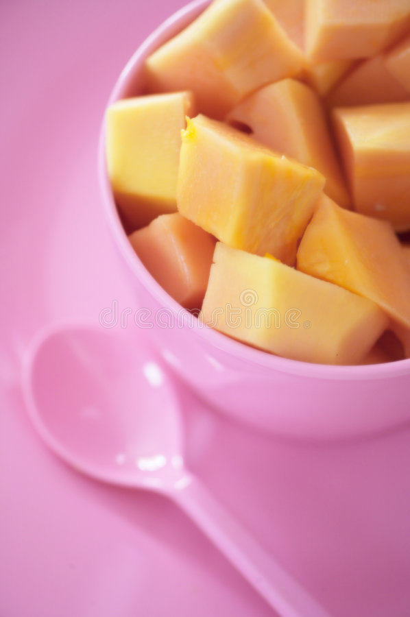 Bowl of mango. Sliced mango in a pink bowl stock photo
