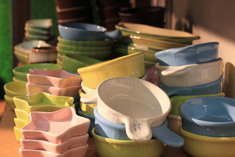 Bowl in many shapes ceramic pottery clay stacked in store shelf hand made craft stock photo