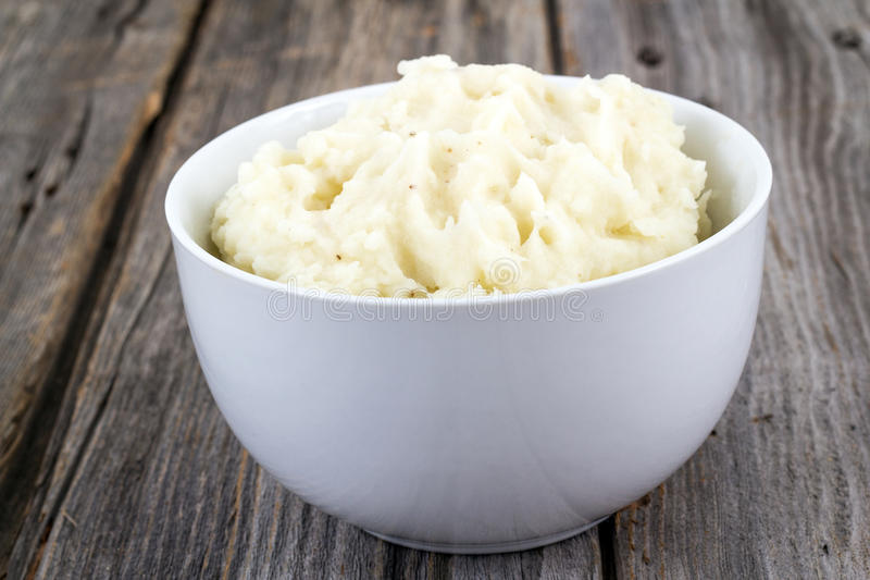 Bowl of mashed potatoes stock images