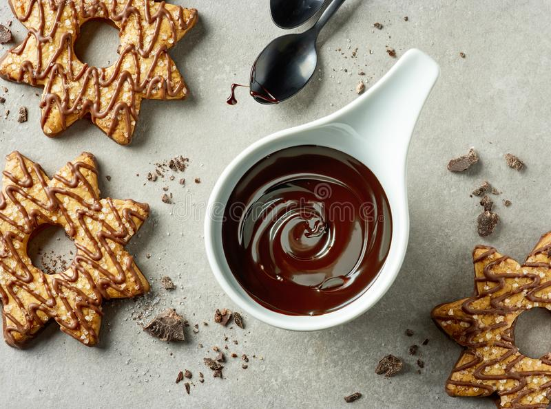 Bowl of melted chocolate stock images
