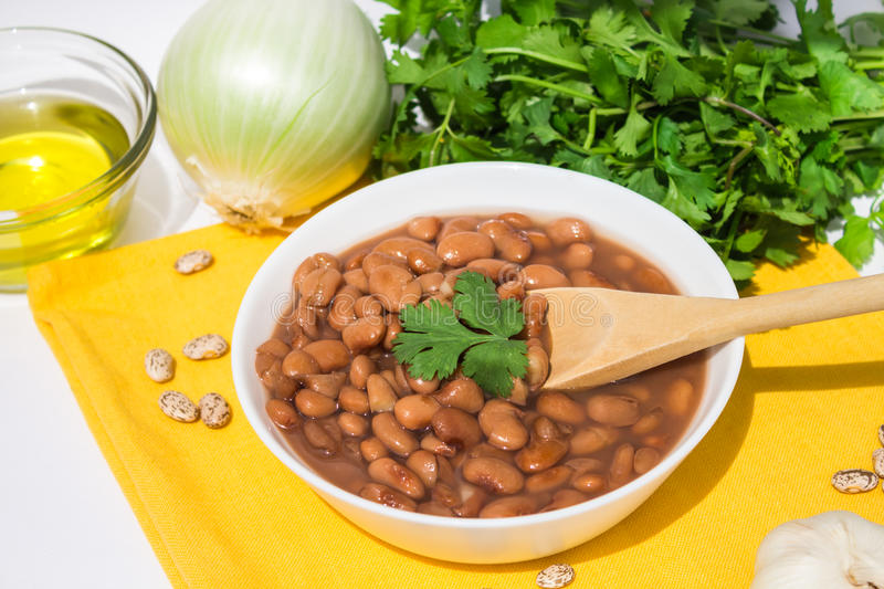 Bowl of Mexican pinto beans stock image