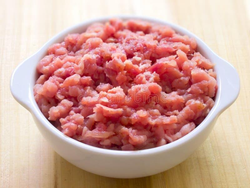 Bowl of minced pork stock image