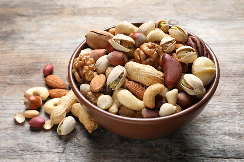 Bowl with mixed organic nuts stock photography