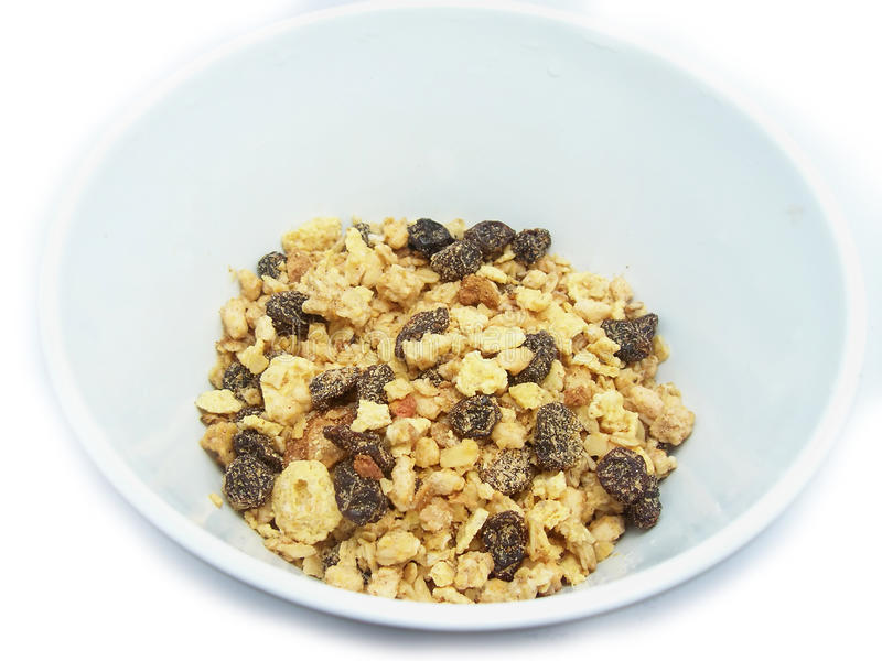 A bowl of muesli. Small amounts of muesli cereal in a bowl stock photo