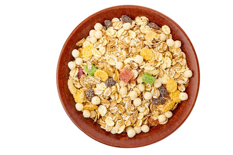 Bowl of muesli with dried exotic fruits on white royalty free stock images