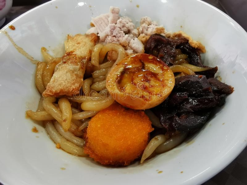 Bowl of noodles with scallop and egg stock photo