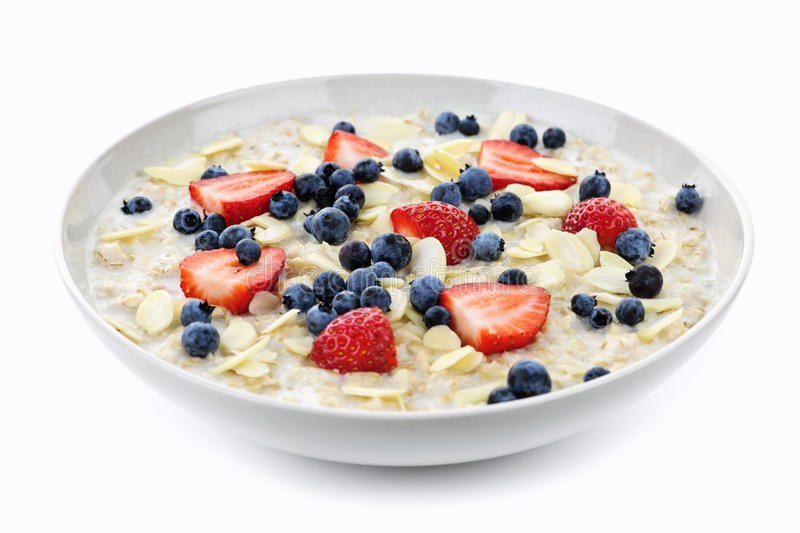 Bowl of oatmeal with berries stock images
