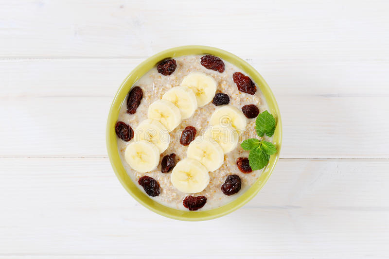 Download Bowl of oatmeal porridge stock photo. Image of full, organic - 83705590
