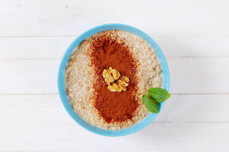 Download Bowl of oatmeal porridge stock image. Image of food, background - 83706123