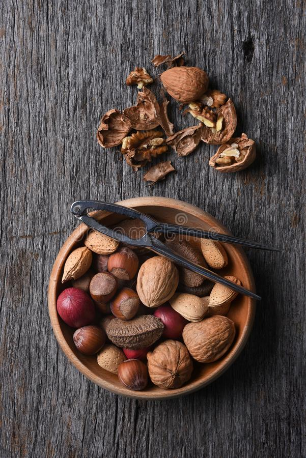 Free Bowl Of Mixed Nuts And Nutcracker Stock Photography - 104377942