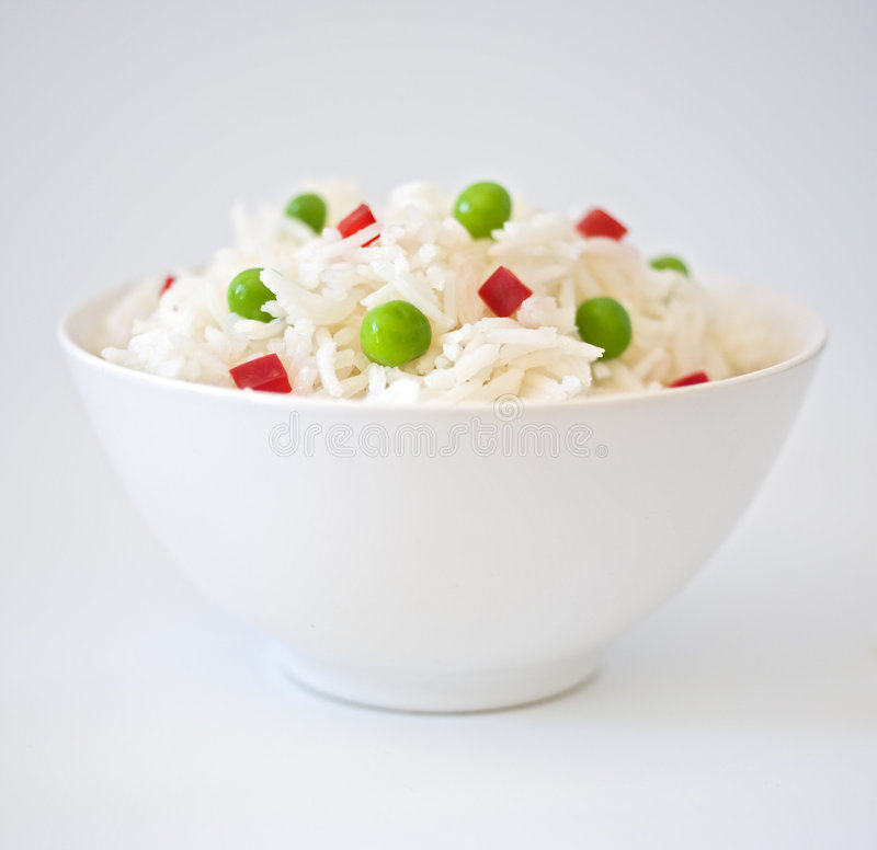 Free Bowl Of Rice With Peas An Peppres Royalty Free Stock Photos - 6975598