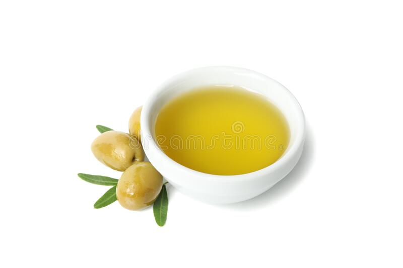 Bowl with olive oil, olives and leaves isolated on background. Bowl with olive oil, olives and leaves isolated on white background stock image