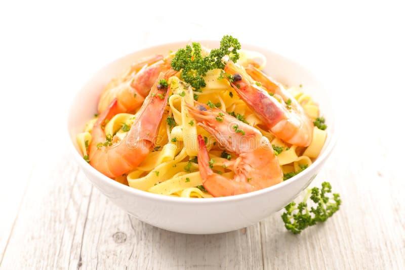Pasta and shrimp stock photos