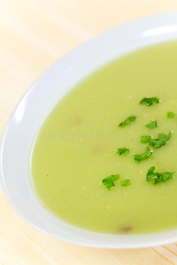 Download Bowl Of Pea Soup Garnished With  Cream And Crouton Stock Photo - Image: 9465900