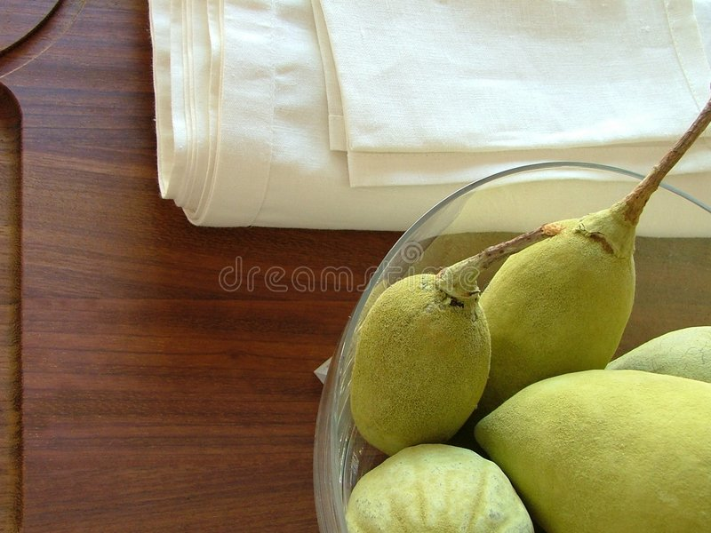 Bowl of pears and towel stock image