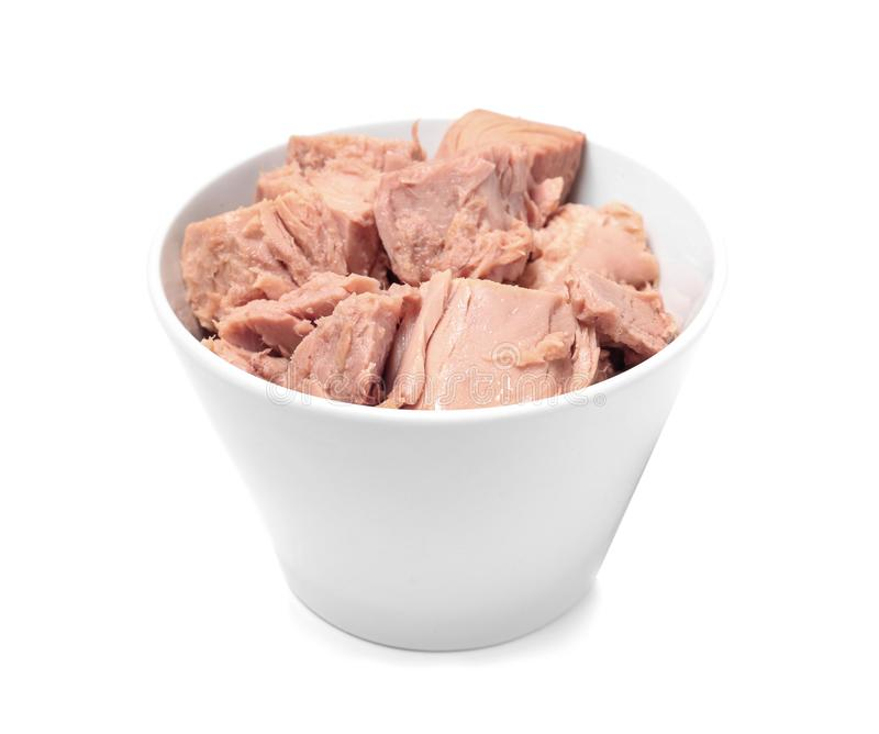 Bowl with pieces of canned tuna on white royalty free stock photography