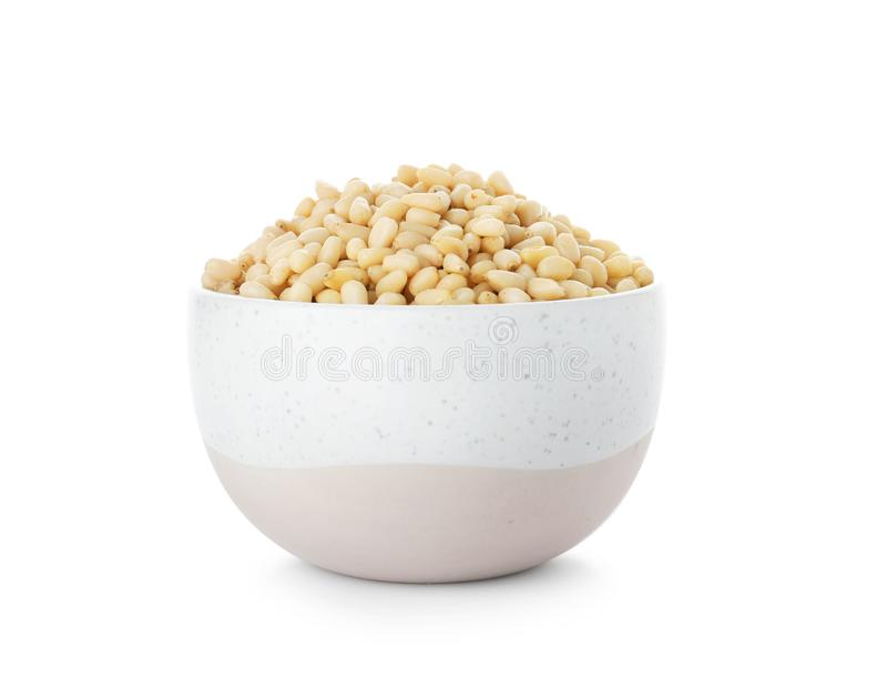 Bowl with pine nuts. On white background stock images