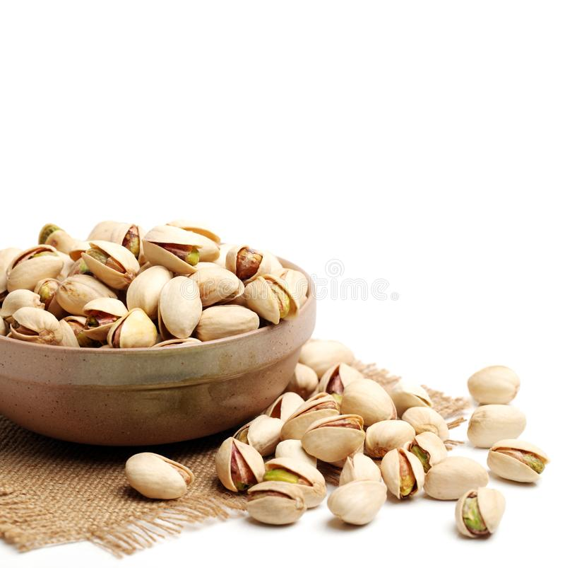 Bowl of pistachio nuts. On the white background stock images