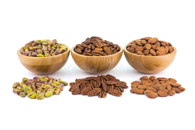 Bowl with pistachio Pecan almonds and spread nuts stock photos