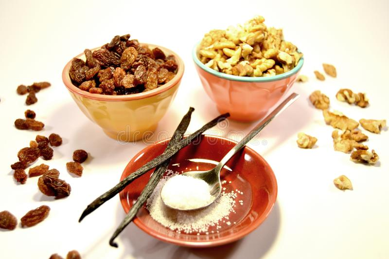 Nuts, sugar, raisins and vanilla stick stock images