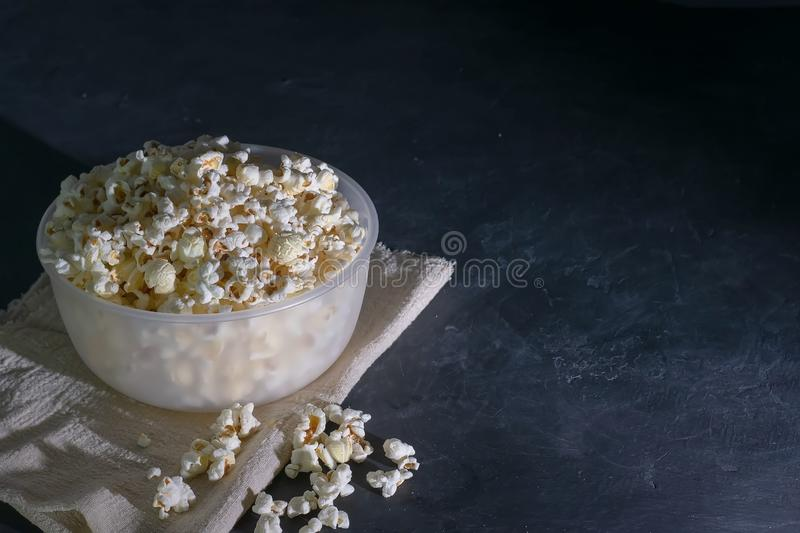 Bowl with popcorn on a black background, selective focus.  royalty free stock image