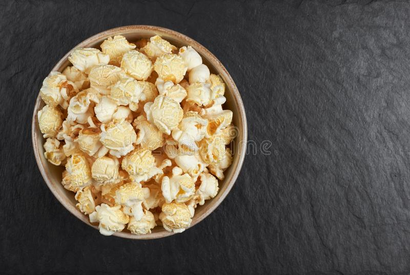 Bowl of popcorn on a stone background. Top view stock photos