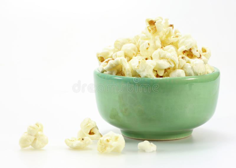 Bowl of popcorn. On white background royalty free stock image