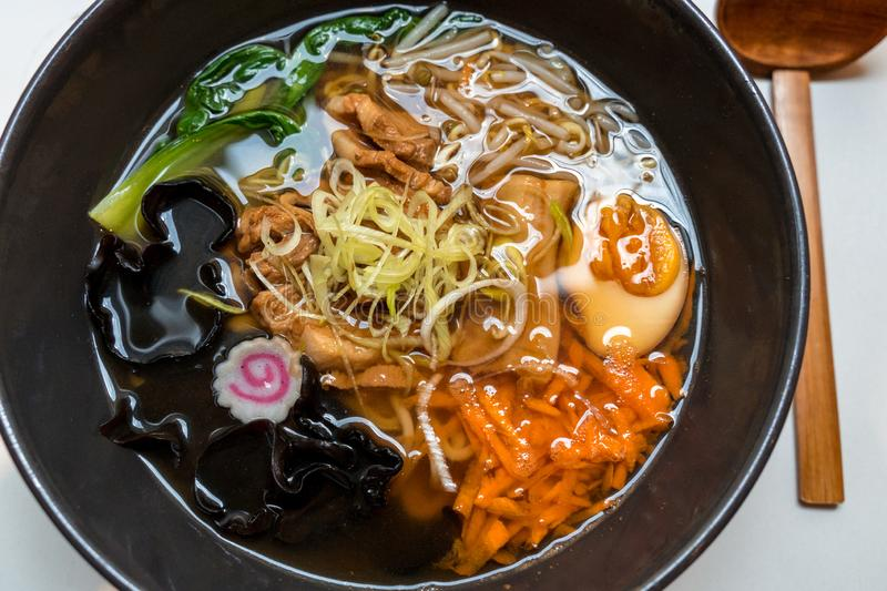 Bowl of pork belly Japanese ramen with  noodles, fresh vegetables and boiled egg stock images